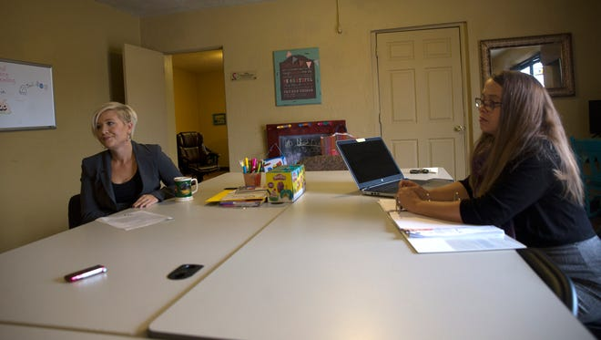 Second Chance Counseling executive director Alisha Hawthorne-Martinez, left, and Rachel Nawrocki, Capacity Builders executive director, talk about their organizations' partnership on Tuesday at Second Chance Counseling in Farmington.