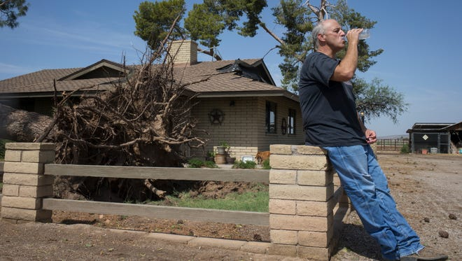 Brian Craft in front of his Palo Verde home July 9, 2018, that was damaged by Sunday night's monsoon storm.