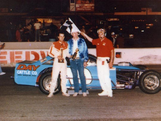 Tony Roper in victory lane in his dirt car.