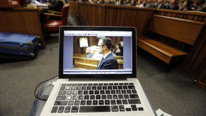 South African Paralympic athlete Oscar Pistorius is seen on the screen of a photographer's laptop during his ongoing murder trial on March 14 in Pretoria, South Africa.