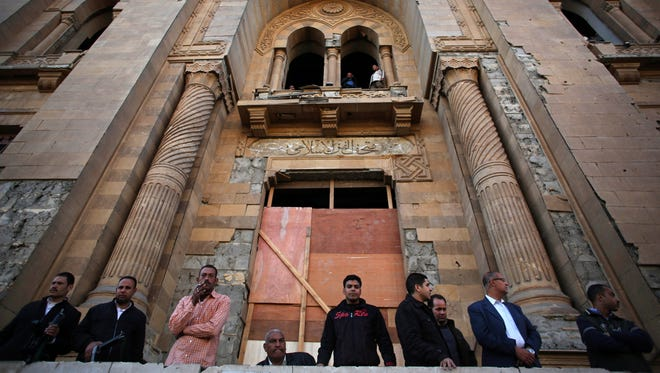 Egyptian security officers stand guard at the entrance of the Museum of Islamic Art after an explosion at the Egyptian police headquarters in downtown Cairo.