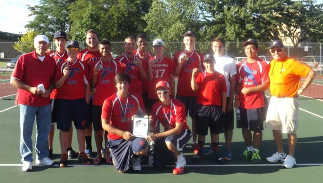 The Livonia Franklin tennis team poses with its first-place plaque after winning the Wayne Memorial Invitational earlier this month.
