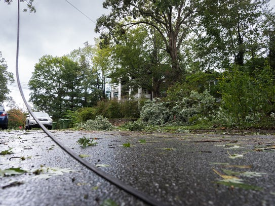 A downed power line and tree limbs on Cumberland Avenue