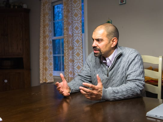 Vijay Kapoor, newly elected Asheville City Council member, responds to questions at his South Asheville home November 8, 2017, following his win.