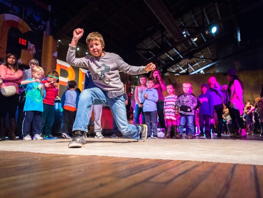 Dylan Biehayn, 11, of Asheville, dances at the Kid