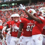Louisvillle wide receiver Ja'Quay Savage points to the crowd as he and his teammates celebrate his late first half touchdown which put the Cards up over Houston Saturday afternoon at Papa John's Cardinal Stadium. Sept. 12, 2015