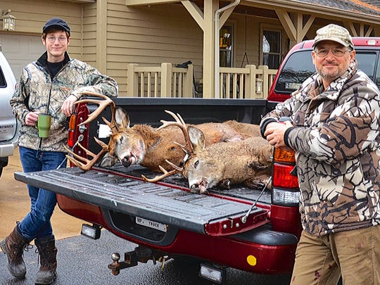 Cooper and Mike Kohlman pose with the bucks they shot on opening day of the 2014 deer season.