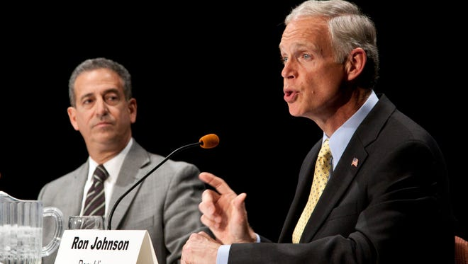Wisconsin senatorial candidates Democrat Sen. Russ Feingold, left, and Republican Ron Johnson participate in a debate Oct. 11, 2010, in Wausau, Wis.