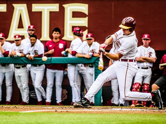 Cal Raleigh (35) gets a hit during USF's 4-2 victory against FSU at Dick Howser Stadium in Tallahassee, FL.