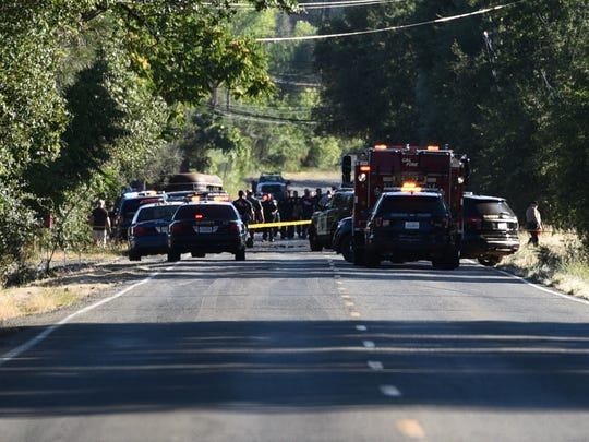 Police swarm around Clear Creek Road in south Redding on Friday, June 22, 2018 after reports of a fatal shooting.