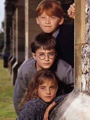 """The stars """"Harry Potter and the Sorcerer's Stone"""": Rupert Grint (Ron Weasley); Daniel Radcliffe (Harry Potter) and Emma Watson (Hermione Granger)."""