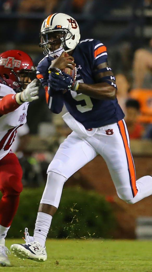 Auburn quarterback John Franklin III (5) carries the