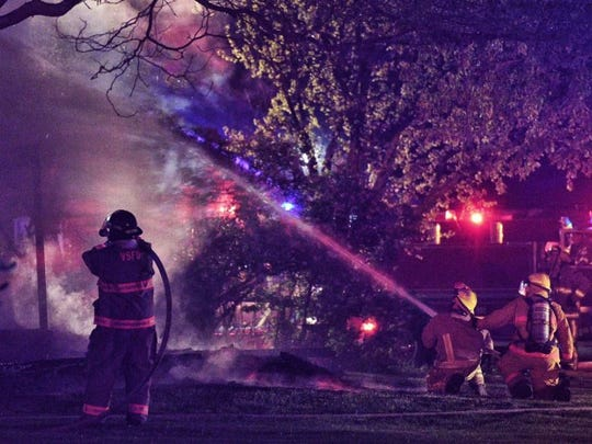 Fire crews work a blaze south of Valley Springs on Saturday night.