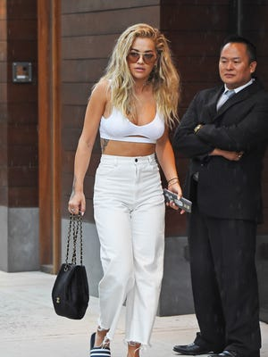 Singer Rita Ora paired a white sports bra-like top with jeans on July 18, 2016, in New York.