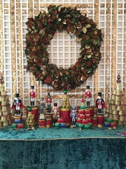 Collin Falvey of Milwaukee was in charge of decorating the Palm Room in the White House for the 2016 holiday season. He and other volunteer decorators used traditional, classic Christmas colors and decorations for the room.