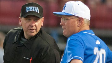 UK head baseball coach Gary Henderson has a talk with the home-plate umpire.