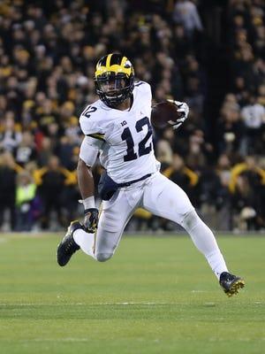 Michigan running back Chris Evans runs for a first down against Iowa on Nov. 12, 2016.