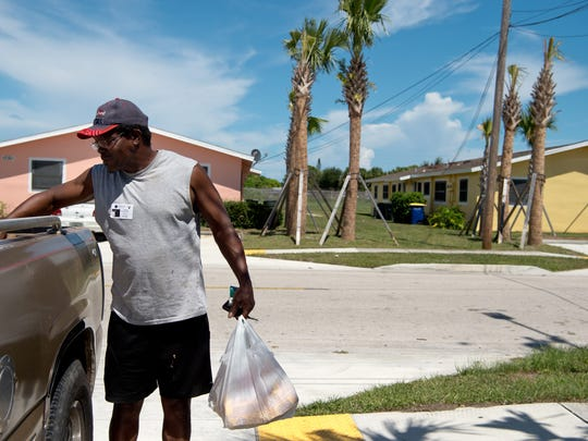 Michael Avant, who lives on North 31st Street in Fort Pierce, unloads groceries Aug. 17, 2016, outside his home. The Fort Pierce public-housing resident said crime-free housing policies don't help when the people committing crimes in the neighborhood aren't residents.
