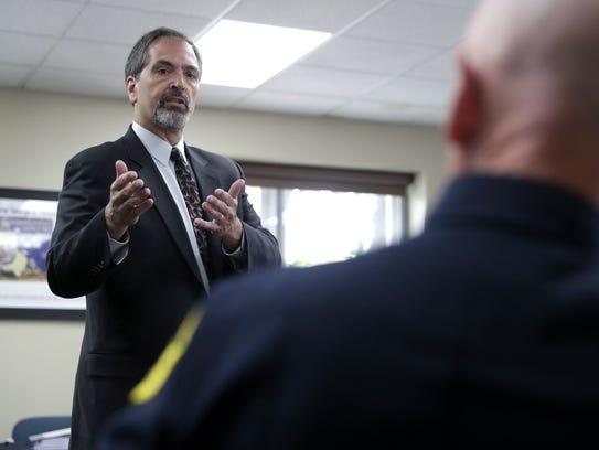 William Rettko, attorney for suspended Green Bay Police Officer Paul Spoerl, gestures to Chief Andrew Smith during his opening statement Wednesday at a Police and Fire Commission hearing that will determine whether Spoerl keeps his job.