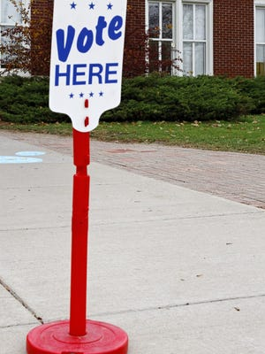 A sign directing voters where to vote.