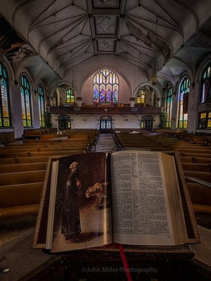 A bible sits on the pulpit of an abandoned church. ©John Miller Photography.