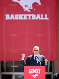 Larry Brown speaks during his introduction as SMU men's basketball coach in front of Moody Coliseum in Dallas on Monday, April 23, 2012.