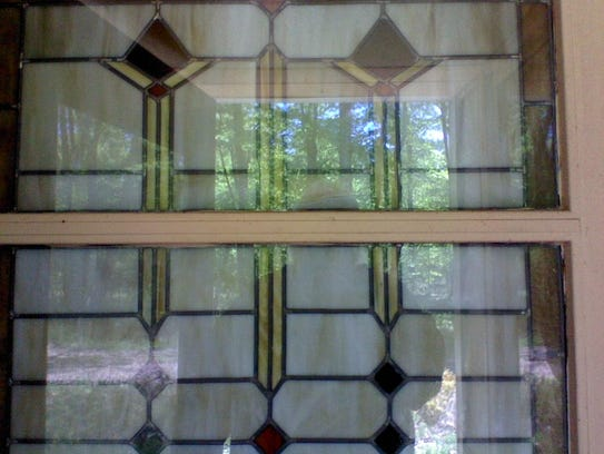 """A close-up view of a stained glass window at the """"secret"""