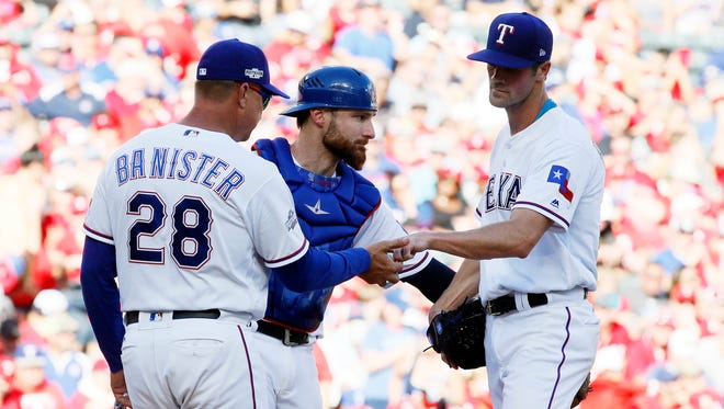 """""""Now you're rushing a sport not known to be rushed,"""" Rangers pitcher Cole Hamels says of a proposed pitch clock."""