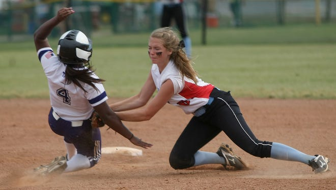 University School of Jackson's Kallie Pickens (8) applies the tag to The King's Academy's Kristina Brown (4) as she slides into second base during Spring Fling at Starplex in Murfreesboro on May 26, 2016. The umpire called Brown safe.