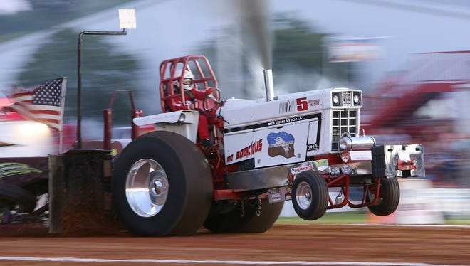 Randy Thomas pilots the Bad Bodacious during the 45th Annual Budweiser Championship Tractor & Truck Pull & Battle of the Monster Trucks at Jackson Fairgrounds Park on Friday, June 10, 2016.