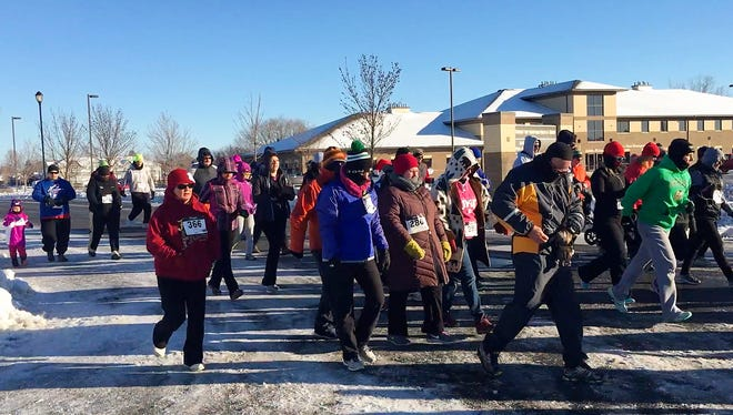Runners start their 5K race at the annual Jingle Bell Run in Sartell Saturday, Nov. 19. Money raised by the event goes to Toys for Tots.