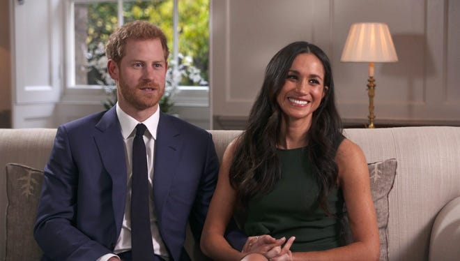 In this photo taken from video Britain's Prince Harry and Meghan Markle talk about their engagement during an interview in London, Monday, Nov. 27, 2017. It was announced Monday that Prince Harry, fifth in line for the British throne, will marry American actress Meghan Markle in the spring, confirming months of rumors.