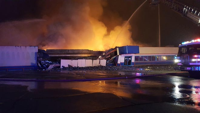 Crews battle a fire at Plaza Lanes in Des Moines on Monday, Dec. 18, 2017. It's one of two fires in Des Moines on Monday.