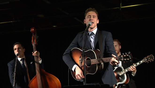 """In this Saturday, Oct. 17, 2015, photo taken from video, British actor Tom Hiddleston performs at Acme Feed & Seed in Nashville, Tenn., following a film premiere for the Hank Williams' biopic """"I Saw the Light."""""""