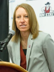 Brooke Atkinson was hired to replace Mark Trakh as the New Mexico State University women's basketball coach.