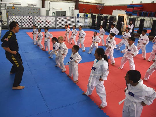 Guam Taekwondo Center Chief Instructor Master Noly Caluag teaches a children's class.