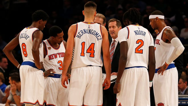 New York Knicks head coach Jeff Hornacek talks to his players during a timeout in a recent game.