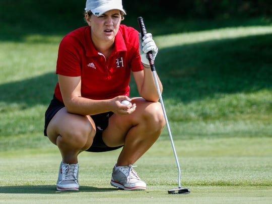 Homestead's Isabelle Maleki eyes up a putt during the