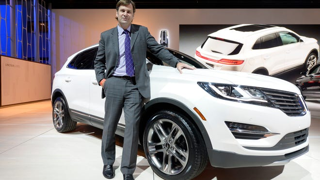 Jim Farley, executive vice president for Ford, with a Lincoln at the Los Angeles Auto Show