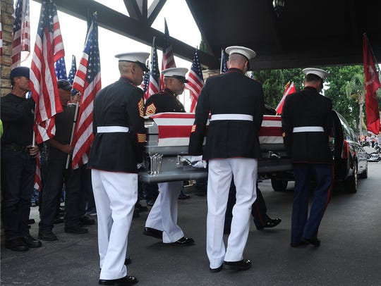 The casket of Marine Corps Staff Sgt. Robert Cox was
