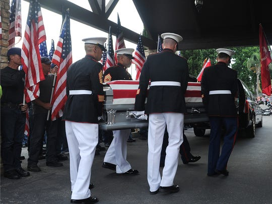 The casket of Marine Corps Staff Sgt. Robert Cox was carried into the Ted Mayr Funeral Home in Ventura after it arrived from Los Angeles International Airport.