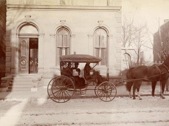 A vintage photo shows the exterior of the historic brownstone located at 153 W. Market St. The York County Library System will spend nearly $800,000 to renovate the exterior of the building by mid-September. Photo courtesy of the York County History Center.