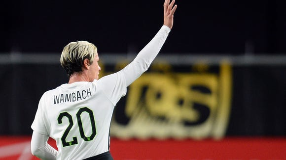 Abby Wambach salutes fans during a game against China Dec. 13 at the University of Phoenix Stadium.
