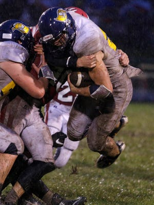 Pewamo-Westphalia's Jared Smith, right, leads the Lansing area in rushing.