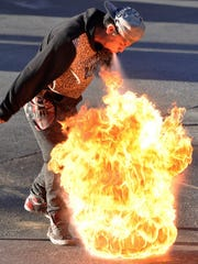 Firebreather Alfredo Humberto Velásquez can be seen performing at street corners in Juárez. He holds diesel fuel in his mouth, then spits it out at a lighted torch, creating a burst of flame. He's 17.