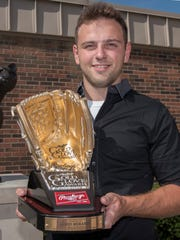 Jared Merandi proudly accepts the Rawilings Gold Glove trophy for his fielding prowess with the Schoolcraft College Ocelots.