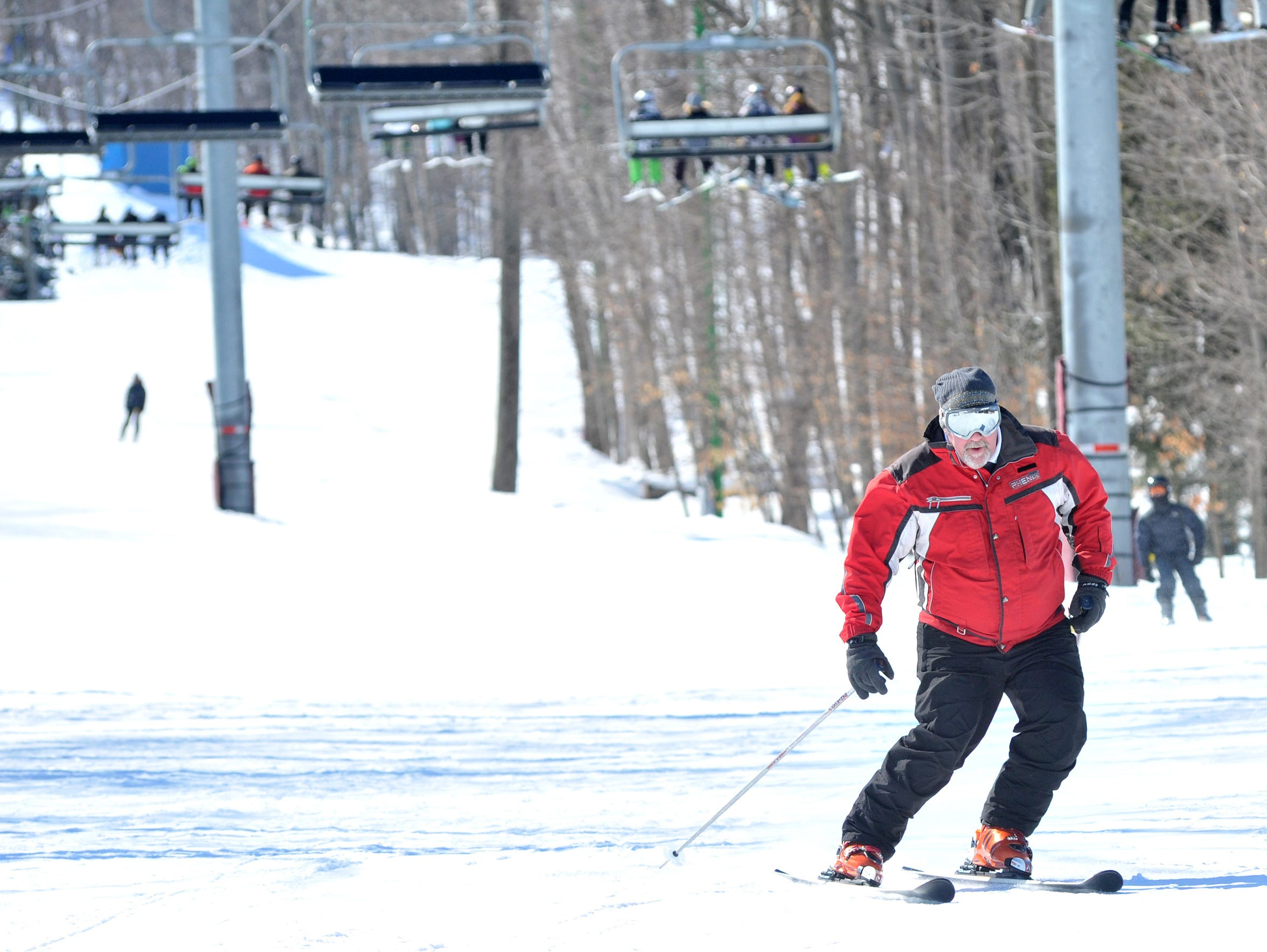Skiers enjoy their Sunday downhill ski at the Granite