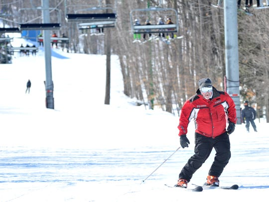 Skiers enjoy their Sunday downhill ski at the Granite Peak in Rib Mountain.