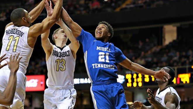 MTSU guard David Simmons goes up for a block in a game against Vanderbilt in Nashville, Tenn., on Dec. 6, 2017.