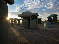 On the western edge of the Sandhills of Nebraska near the town of Alliance, Carhenge, a series of 38 vintage American cars, painted grey to mimic the monoliths of Stonehenge, is an Americana-style replica of the famous British attraction.
